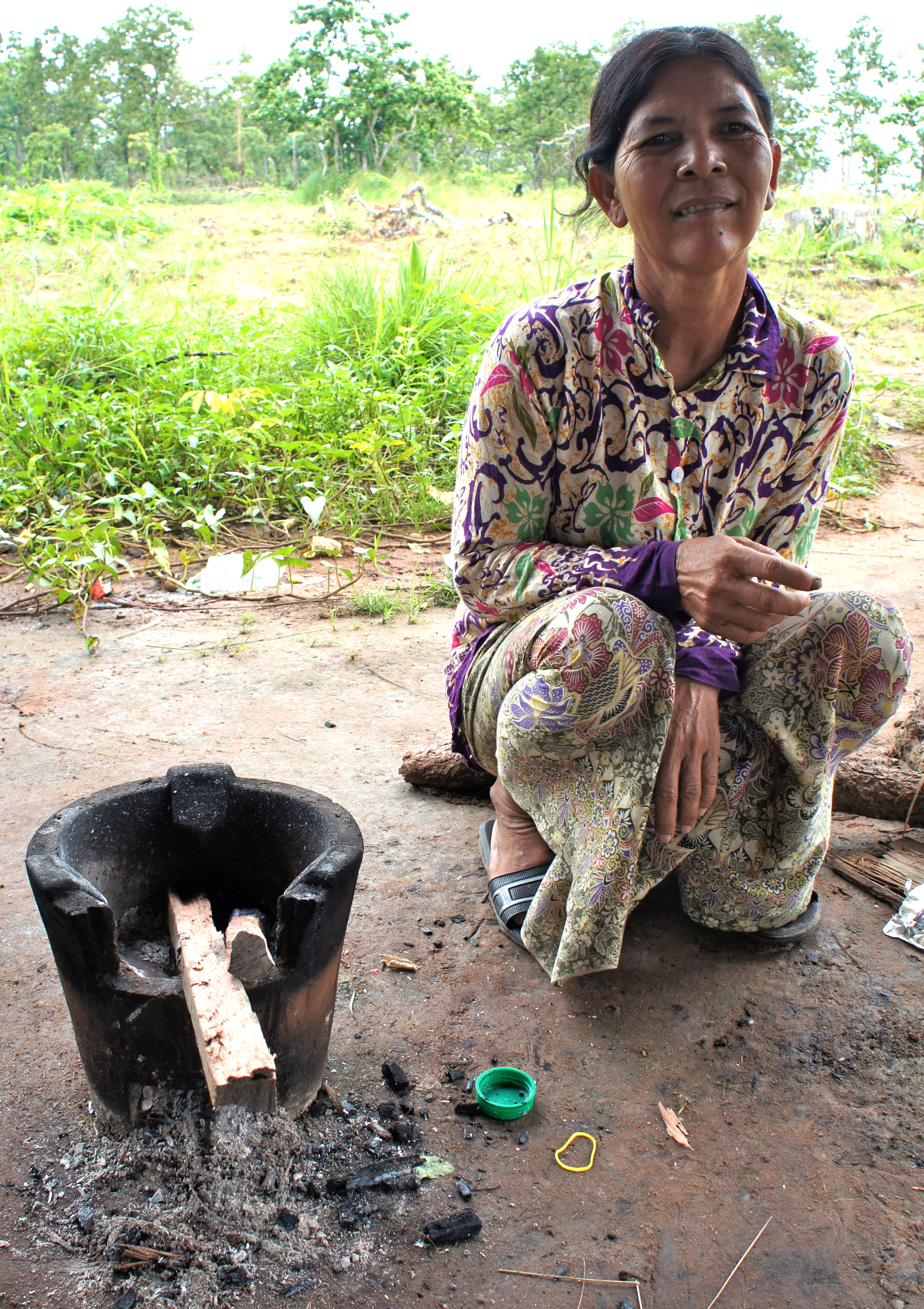 Cambodian lady with cookstove